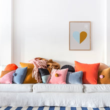Velvet Cushions on sofa by Castle. Rainbow. Butterscotch Bumble Blanket. Blue and white stripe rug