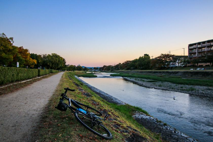 The iconic cycle path along the Kamo river, Kyoto. We return from the mountains down this river.