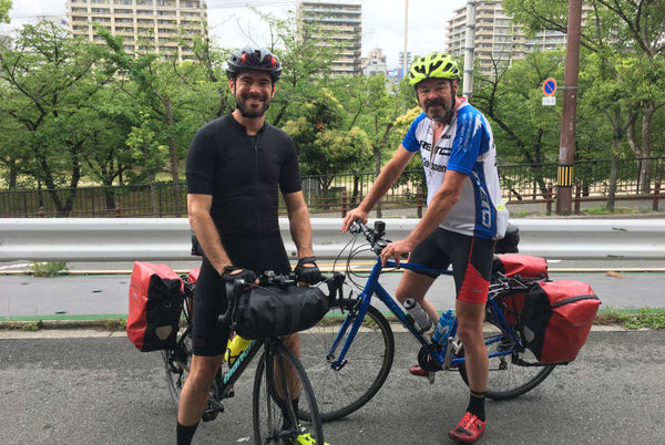 Cyclists with panniers before they head off on their trip.