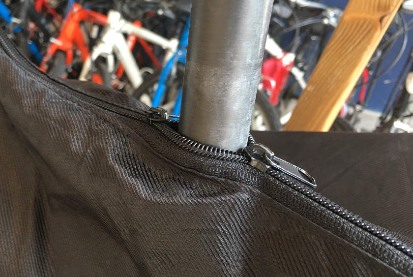 Bag zipped up around seat post.