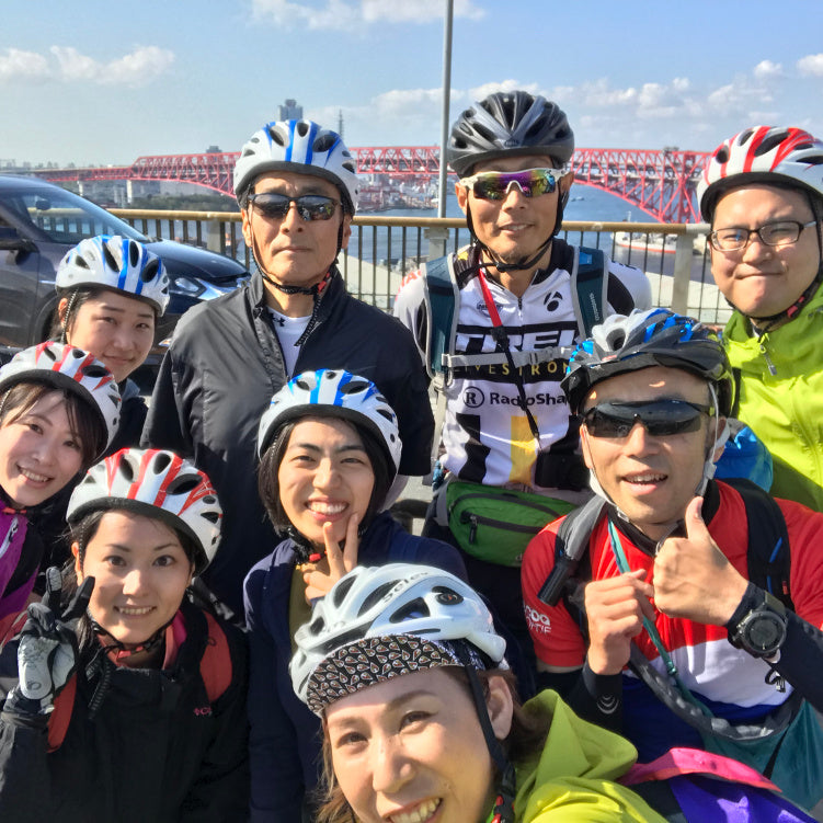A group of happy cyclists taking part in a Globalwheels guided cycling tour of Osaka.