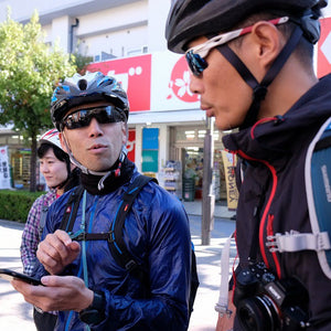 Two of the Globalwheels tour guides discussing routes on a guided tour of Osaka.