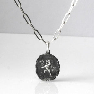 THE BLACK LION AMULET COIN NECKLACE Lion Necklace Hetariki Jewellery
