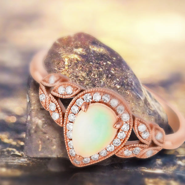 0.47ct Opal Pear Halo Ring in 9ct Rose Gold