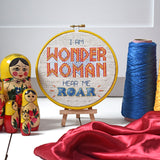 Wonder Woman hear me roar cross stitch kit framed in a hoop with threads and fabric