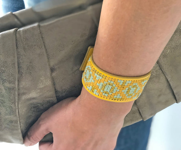 Cross stitch cuff with gold handbag