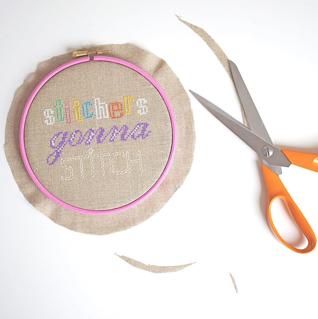 Place your stitching in a hoop and trim excess fabric