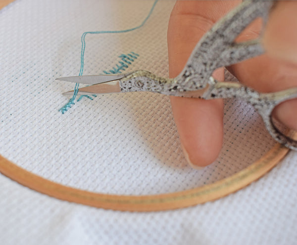 Snip the thread after securing it - how to cross stitch