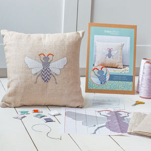 Cross stitch cushion cover kit featuring herringbone hornet design