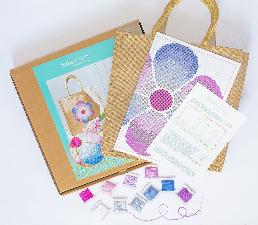 A bag, colour pattern, needle, instructions and DMC threads are included in the fading flower jute bag cross stitch kit