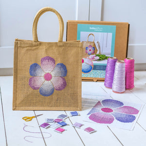 Jute bag cross stitch kit featuring faded flower design
