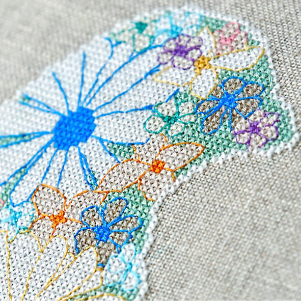 Close up of stitches - floral finch modern cross stitch kit