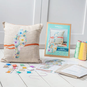 Floral finch cross stitch cushion cover kit - shown with DMC threads