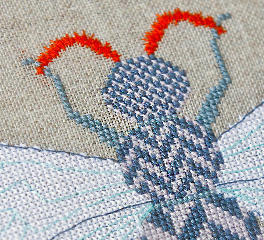 Close up of cross stitches - insect cross stitch kit