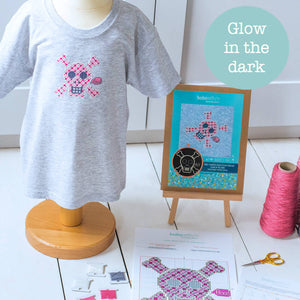 Pink glow in the dark cross stitch kit using soluble canvas