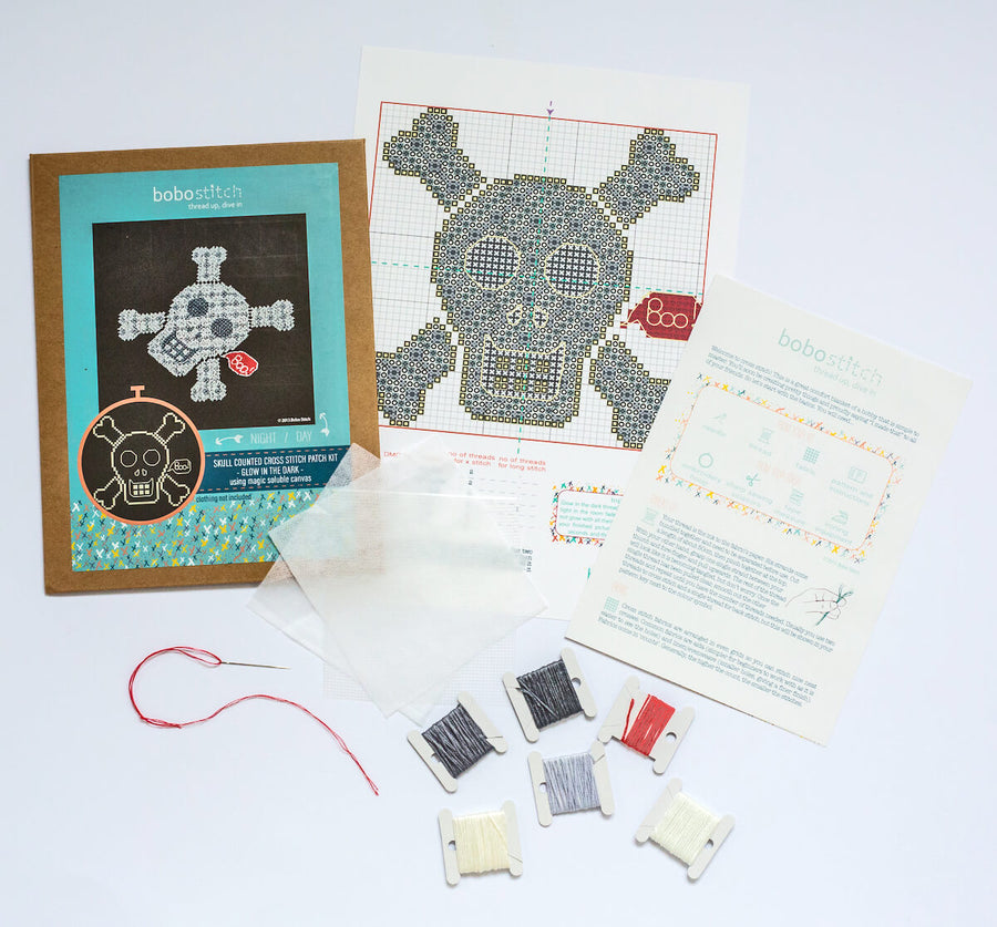 Things included in your glow in the dark skull cross stitch kit