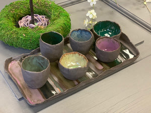 A set of SIX dark ceramic mini bowls and a tray