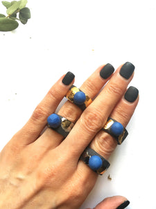 Black porcelain ring with a blue bubble