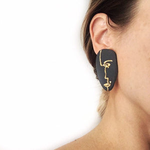 Black porcelain face earrings