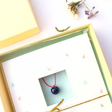 "Load image into Gallery viewer, Ceramic dark blue ""Apple"" pendant on a red string"