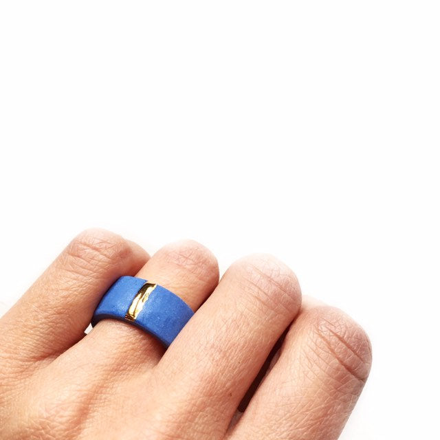 Blue porcelain unisex ring with golden line