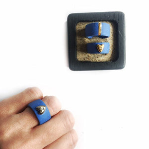 Blue porcelain ring with a golden heart
