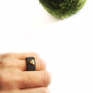 Black porcelain ring with a golden heart