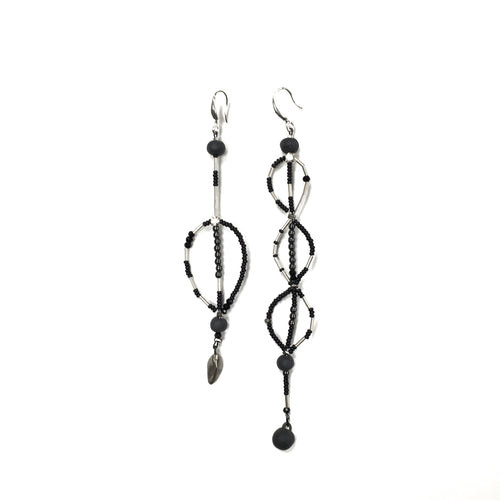 Long assymetric black porcelain earrings