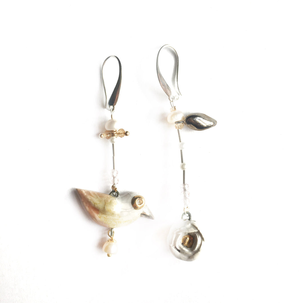 "Ceramic mismatched earrings ""Bird and its white rose"