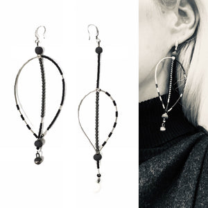 "Black porcelain and hematote light and assymeteic earrings ""November leaves"""