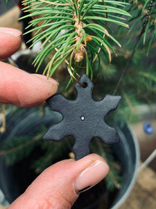 Three black porcelain snowflakes