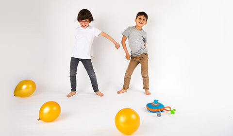 Two kids dancing listening to Jooki Music Player