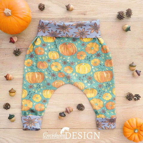 Handmade baby leggings made from organic cotton jersery printed with Ceridwen Hazelchild's Pumpkin Spice pattern and Star Anise cuffs.