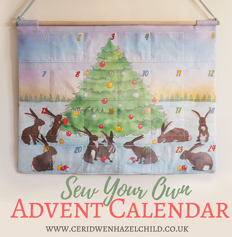 Sew Your Own Advent Calendar kit by Ceridwen Hazelchild, featuring an illustration of rabbits decorating a Christmas tree.