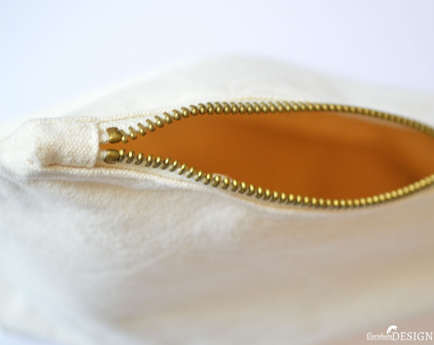 A close-up of a zipper on a canvas wash bag by Ceridwen Hazelchild Design.