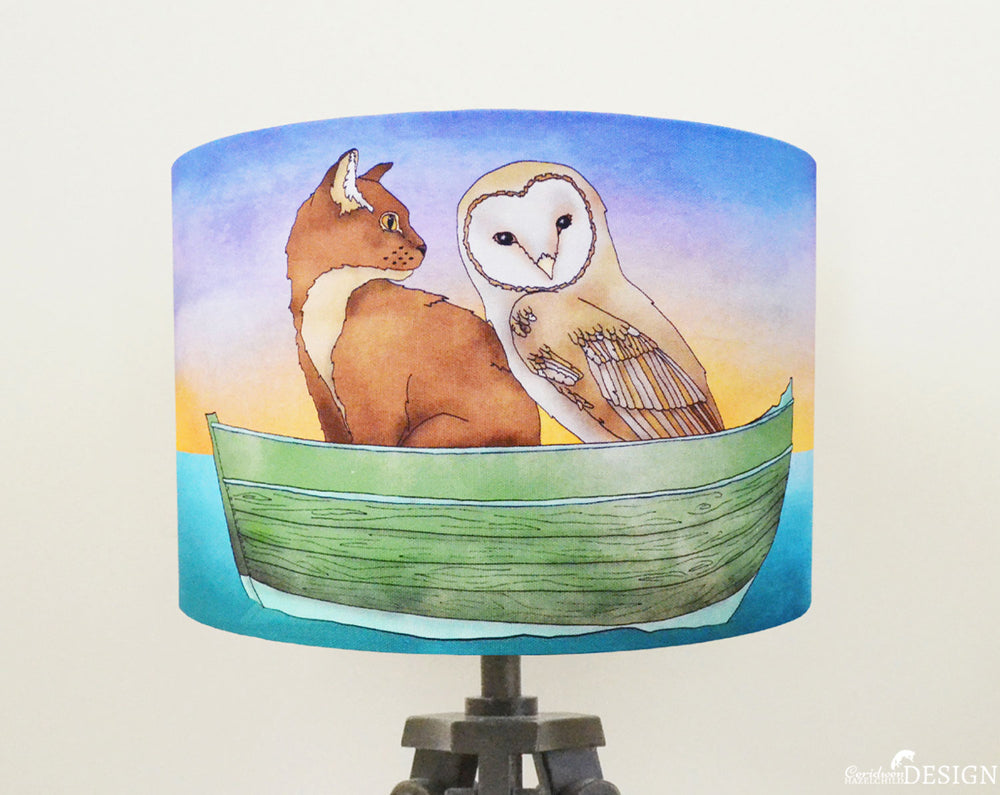 A lampshade featuring an illustration of the Owl and the Pussy Cat, designed and handmade by Ceridwen Hazelchild Design.