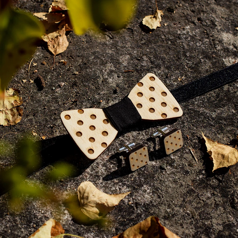 Wooden dotted polka dot bowtie and cufflinks made from Finnish birch plywood.