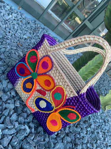 Purple handmade palm bag with two vibrant flowers