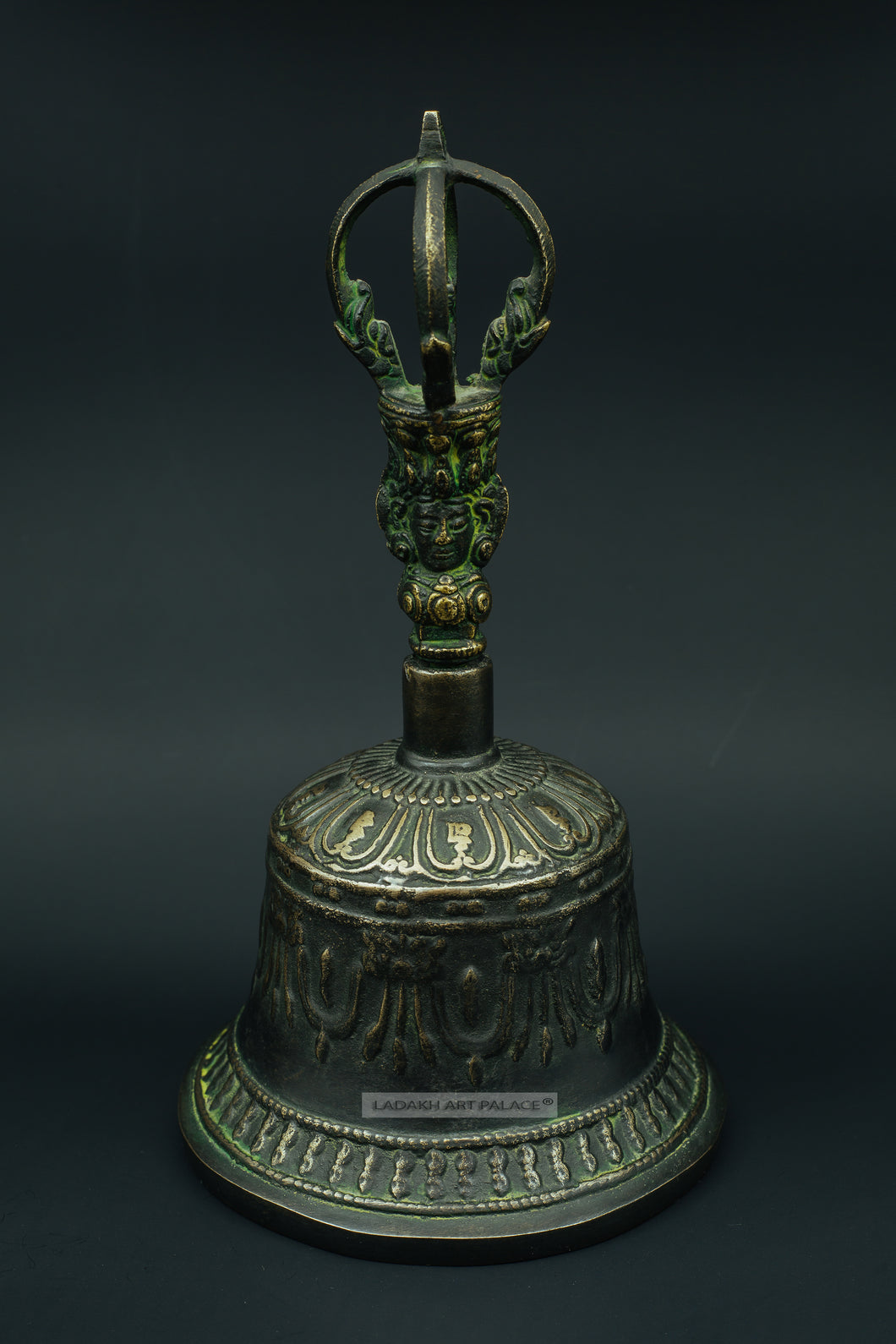 Old brass bell with Buddha face - the ladakh art palace