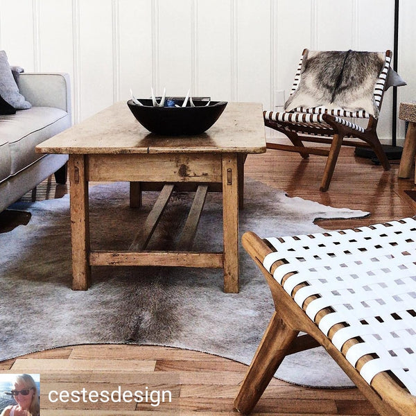 Decorating a simple Cabin with our cowhide rug.