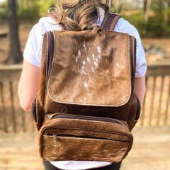 I love this cowhide diaper backpack the leather handles and the interior pocket. There are less attractive cowhide bags out there for triple the price so I'm thrilled with this purchase!
