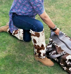 Loving this cowhide duffle purse its very well made, soft and smells amazing and is just beautiful and great quality.