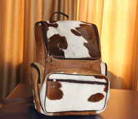 brown and white cow fur bag