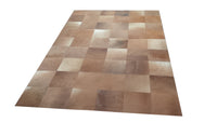 Brown cowhide patchwork rug
