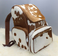 Since each mommy backpack is hand made, each cowhide is slightly different, making each backpack unique perfect for a Easter or Christmas gift.