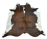 This beautiful cowhide rug is great for kids room in a farmhouse, the brown and white with some black is stunning, there is no folds or creases.