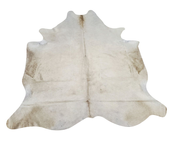Beautiful butter cream cowhide rug amazing to add the classic touch to the living room and can be mixed or layered with other natural rugs