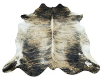 Exactly as pictured this Brazilian grey tricolor cowhide rug in an exotic brindle pattern will please all your friends and family, to add it as a gift.