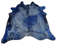 A large dyed blue cowhide rug selected for a stunning shine, soft touch and hundred percent real cowhide perfect for any interior.