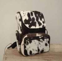 If you are wondering where to buy cowhide backpack we customized all our bags according to your needs, we can also add cowhide camera bag in matching brown white.